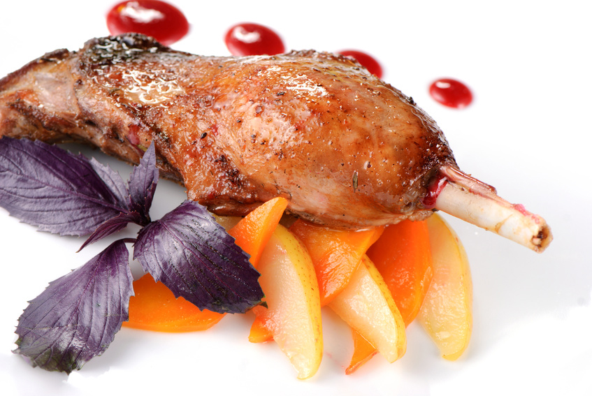 Baked goose leg with pear